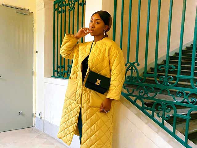 @nnennaechem wearing a yellow quilted jacket, jeans and black mules