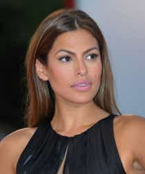 Eva Mendes wears a black dress and a blush-pink lipstick on the red carpet.