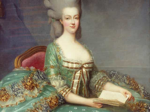 Queen Marie Antoinette sitting on chair open book