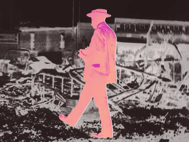 Man walking through historic Black community
