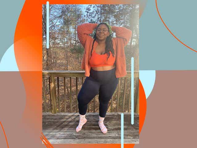 Chichi wears navy Lululemon leggings with bright orange bra.
