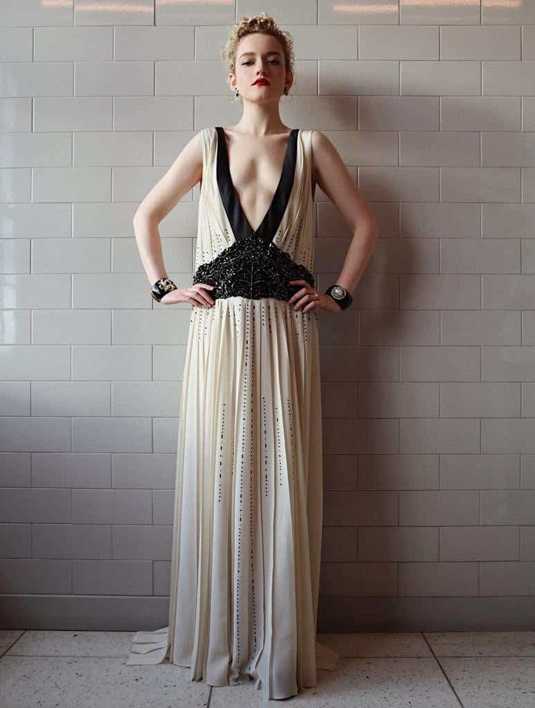 Julia Garner wearing an ivory and black Prada dress for the Golden Globes.