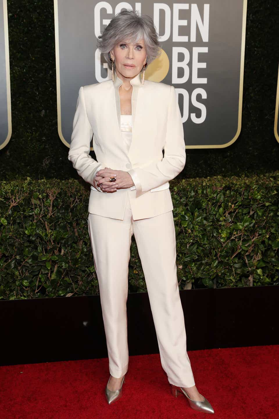 Jane Fonda in a white suit at the Golden Globes.