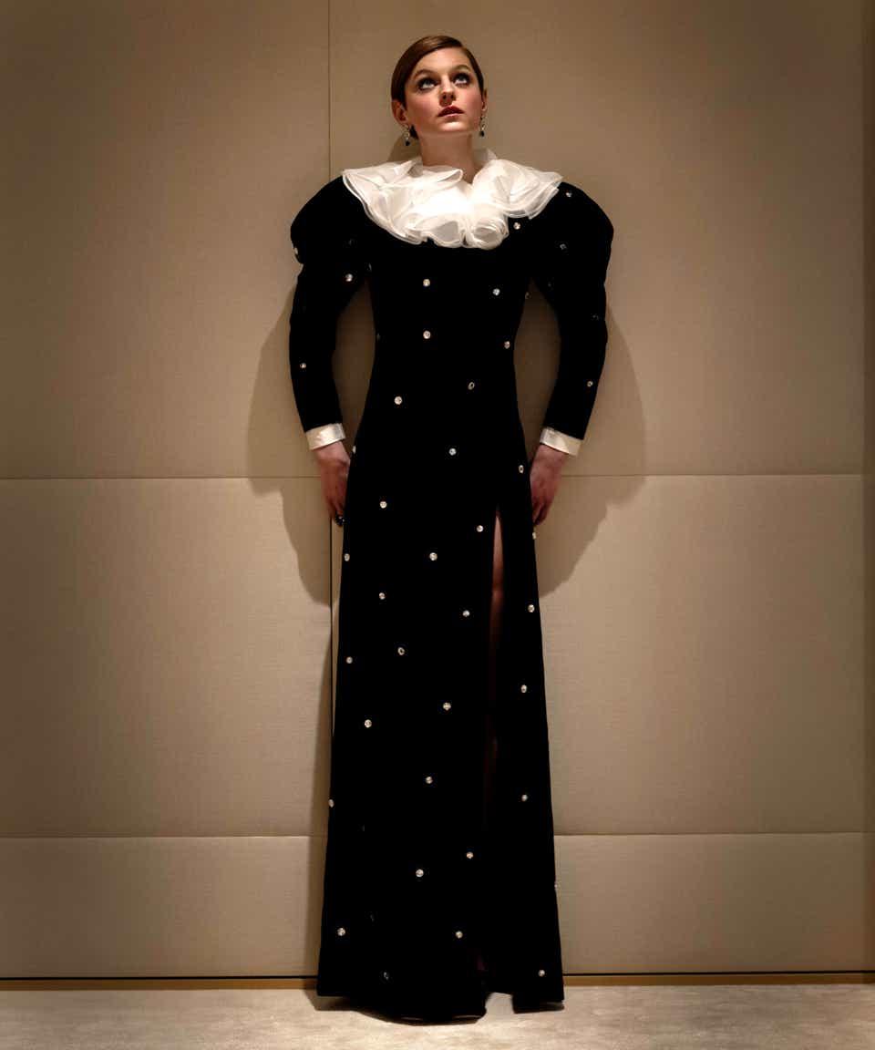 Emma Corrin in a black, velvet Miu Miu gown.