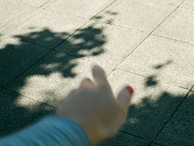Image of a persons hand which is blurred to represent shaking from anxiety