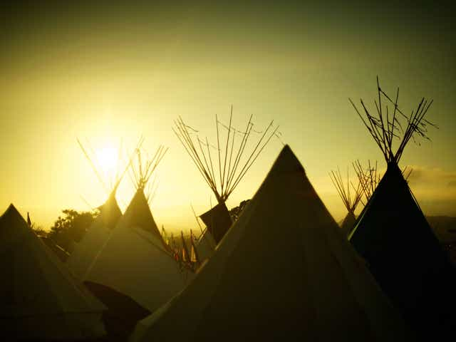 A row of tents at Glastonbury festival.