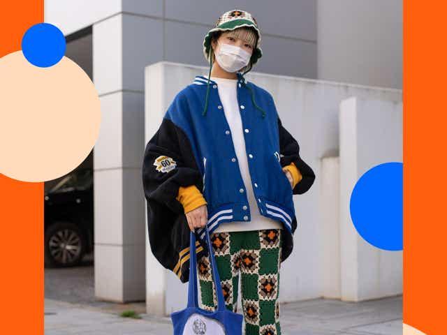 Tokyo Fashion Week guest wearing crocket pants, a crochet bucket hat, and a letterman jacket.