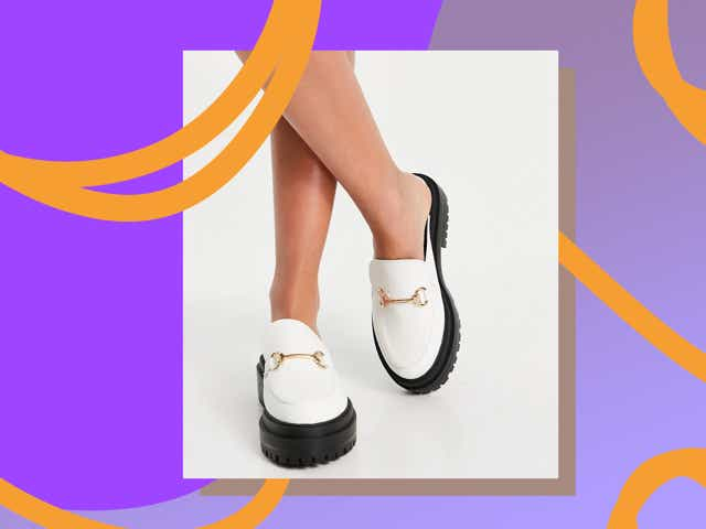 Model wears white slip on loafers with a chunky sole.