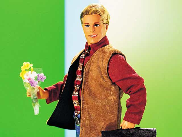 A photo of a Ken doll, carrying a briefcase and a bouquet of flowers