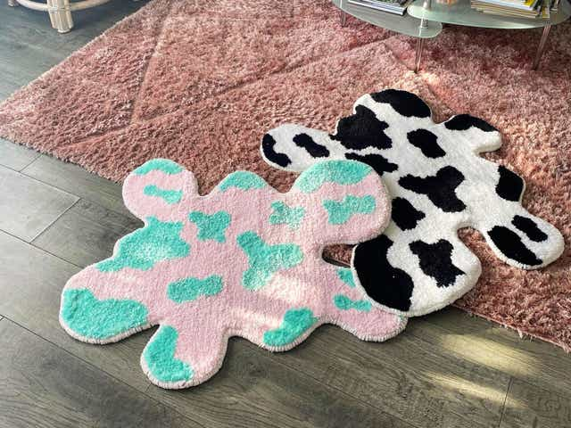 Two unique blob-shaped area rugs with splatter color patterns.