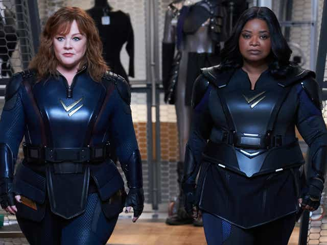 Melissa McCarthy and Octacia Spender walk in superhero suits as their Thunder Force characters.