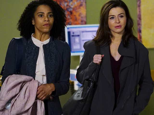 KELLY MCCREARY and CATERINA SCORSONE as their characters on Grey's Anatomy.