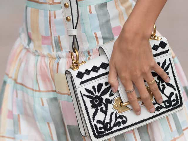 Sarah Ellen wears an Aje dress and Prada handbag
