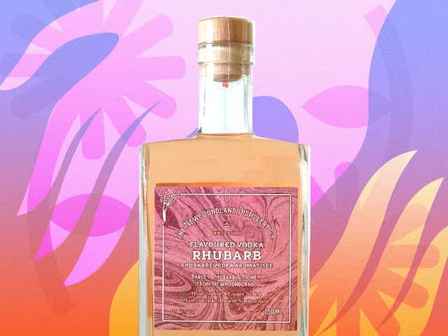 Pink rhubarb vodka bottle on colorful flower background