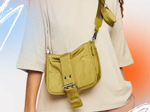 Model wearing olive green satin crossbody bag from Topshop, available on sale at Nordstrom Rack.