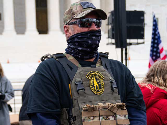 A member of the right-wing group Oath Keepers stands guard during a rally in front of the U.S. Supreme Court Building.