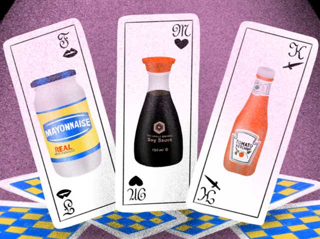 Playing cards with mayo, soy sauce, and ketchup on them.