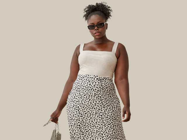 Reformation model wearing a grey tank top and printed midi skirt