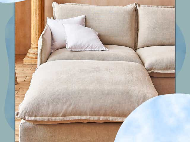 A puffy beige Sixpenny down-cushion couch with a cloud design border.