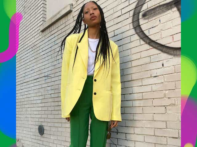 Dominique Babineau wearing a yellow blazer with green pants.