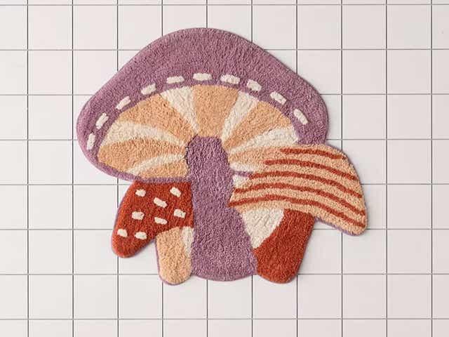 Tufted mushroom-shaped bath mat.