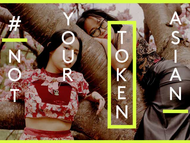 Two East Asian women embracing against a backdrop of cherry blossoms with the words Not Your Token Asian overlaid onto the image.