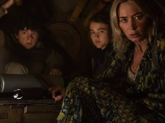 """Marcus (Noah Jupe), Regan (Millicent Simmonds), and Evelyn (Emily Blunt) brave the unknown in """"A Quiet Place Part II.""""."""