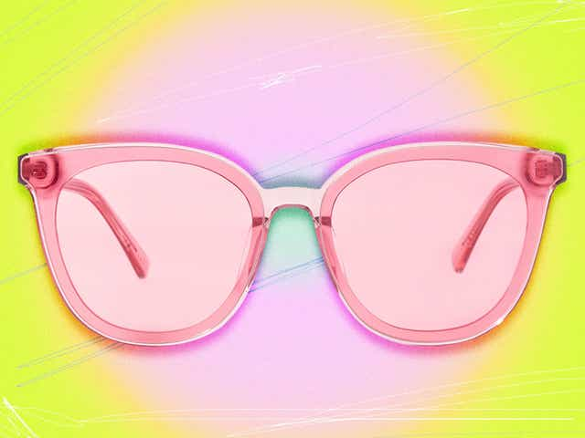 Pink MarsQuest sunglasses on yellow background