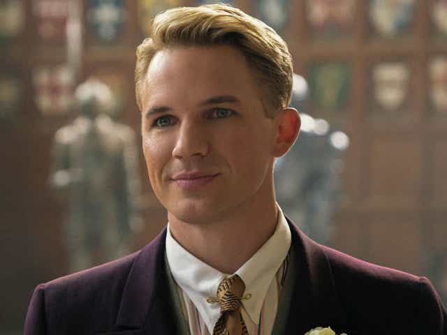 Matt Lander in a suit and tie as his character George in Jupiters Legacy.