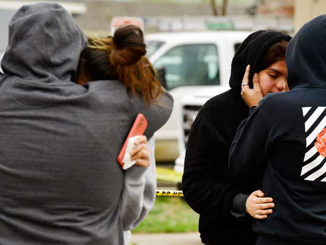 Freddy Marquez, left, hugs his wife Nubia whose mother was one of six shooting victims, and two other relatives hug outside the scene of the shooting at the Canterbury Mobile Home Park on May 9, 2021 in Colorado Springs, Colorado. A gunman killed six people at a family birthday party before taking own life, police said. The victims were all members of the same extended family a party attendee said.