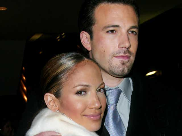 """Jennifer Lopez and Ben Affleck arriving at the """"Maid In Manhattan"""" world premiere after-party at The Rainbow Room in New York City. December 8, 2002."""