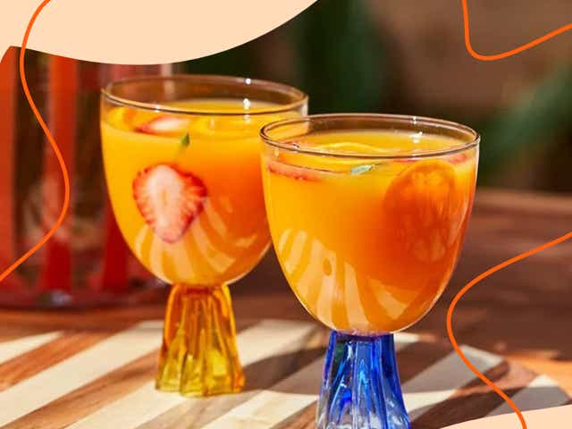Two Urban Outfitters Isla Daisy Goblets filled with orange juice