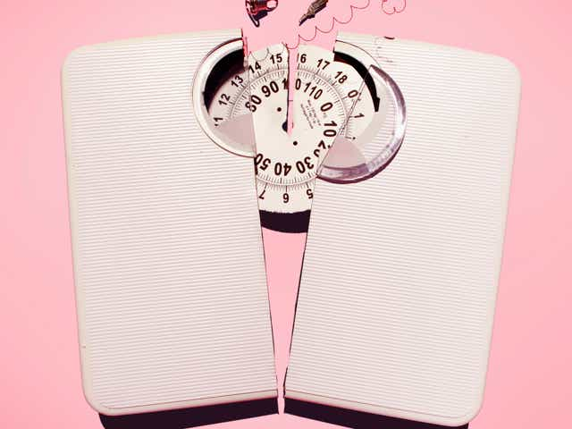 A broken scale on a pink background.