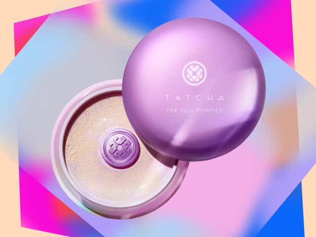 Tatcha's silk powder in purple packaging with a beige and rainbow background