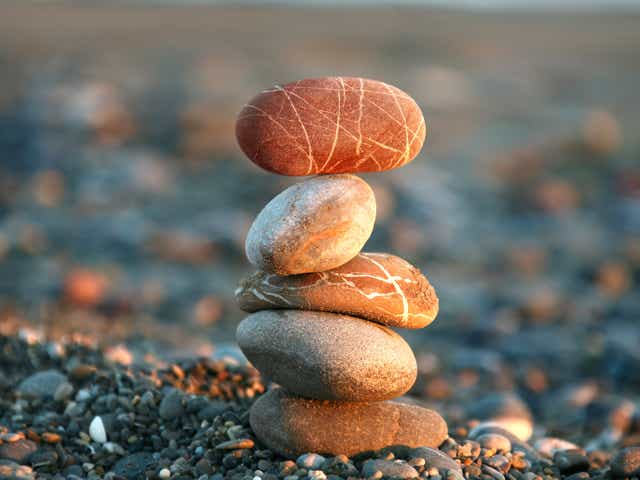 Stacked rocks on a beach.