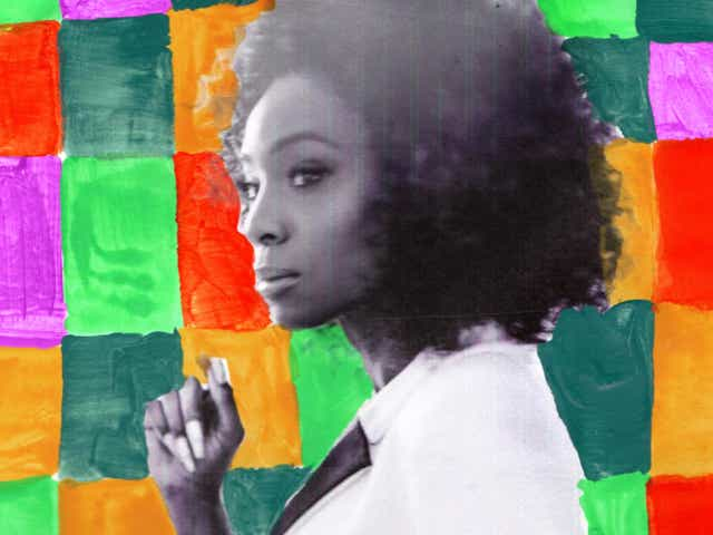 A photo of Angelica Ross with a colorful painted background