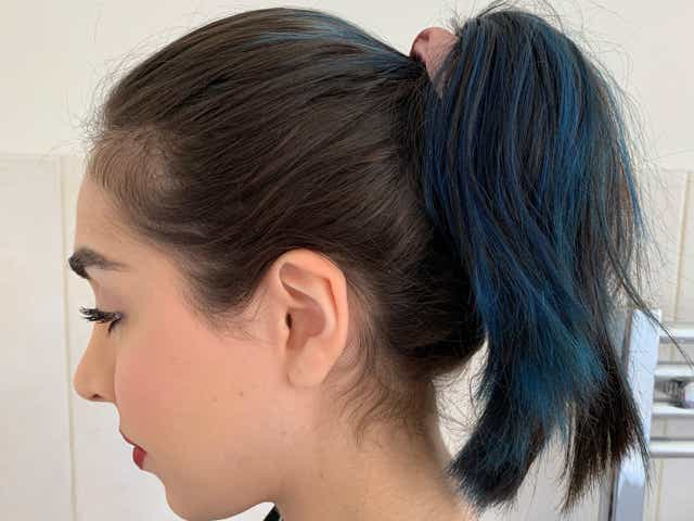 Side profile of Jacqueline showing a high ponytail after the 'perfect ponytail' hack