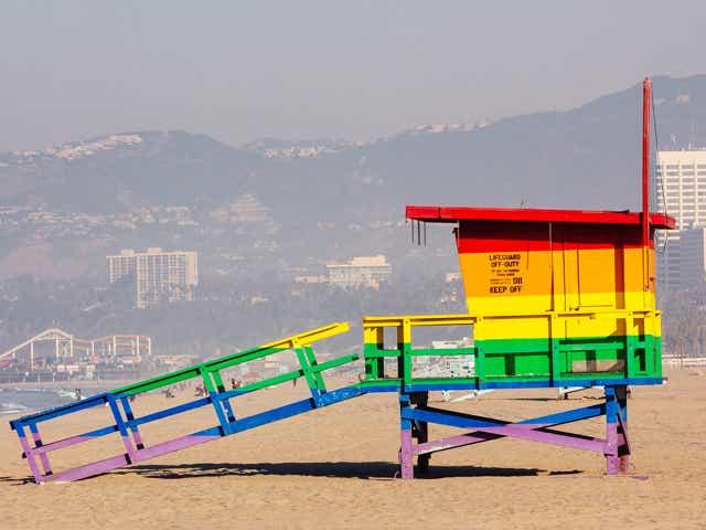 A rainbow lifeguard tower on the beach.