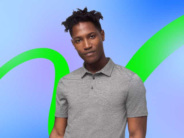 Model wearing a grey polo shirt on a background of blue and green