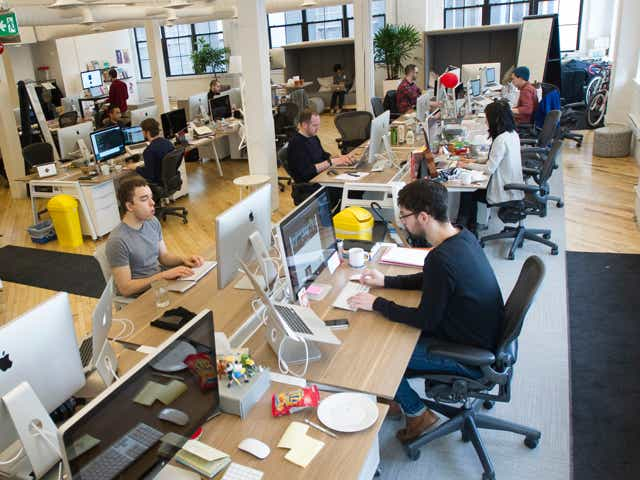 Employees at Shopify Inc. work in their office space in Toronto, Ontario, Canada.
