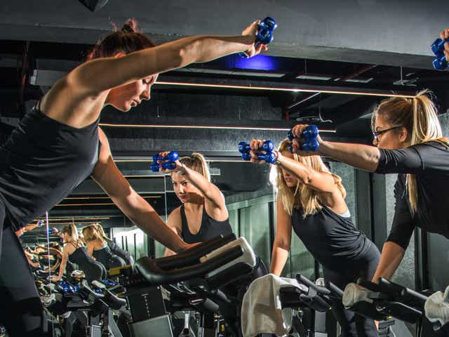 People intensely exercising in a spin class