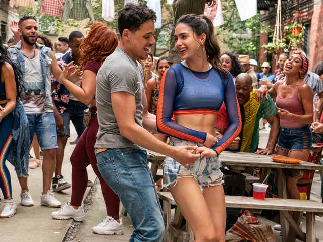 """Anthony Ramos as Usnavi and Melissa Barrera as Vanessa in Warner Bros. Pictures' """"In The Heights""""."""
