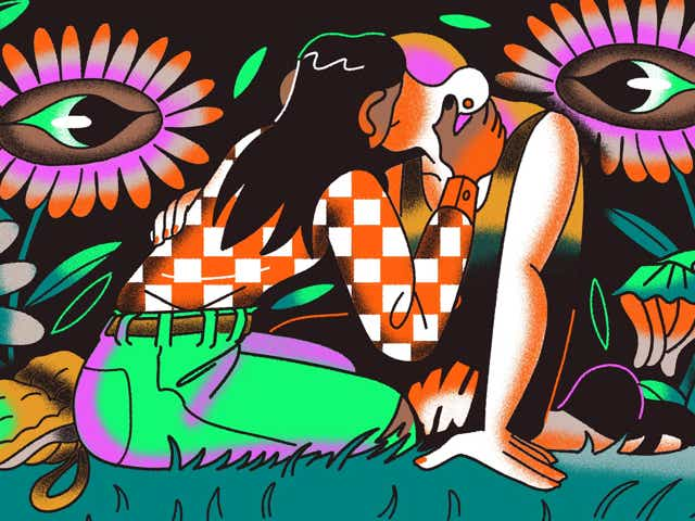 Two femme figures kiss in a surreal field of flowers with eyes.