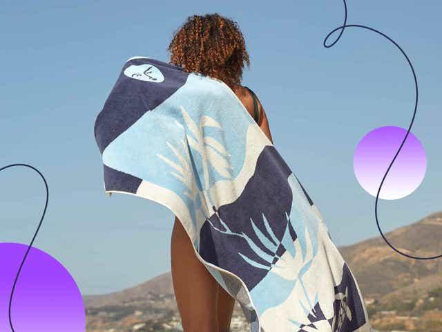 Woman holding blue brooklinen towel behind her back