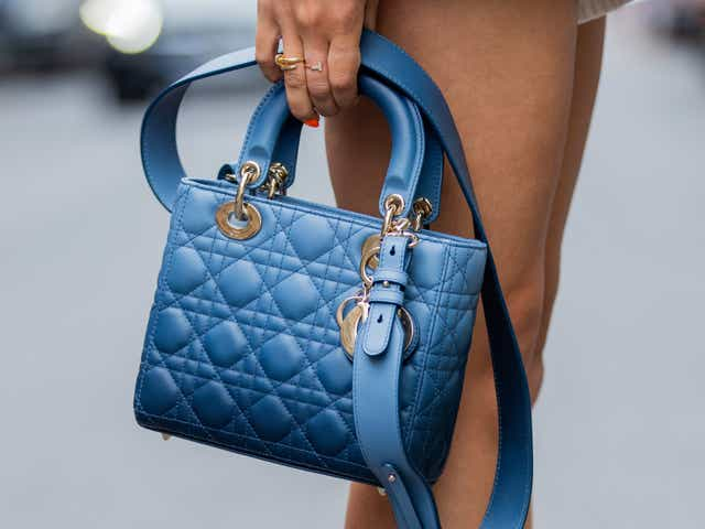 Street style model with a blue purse