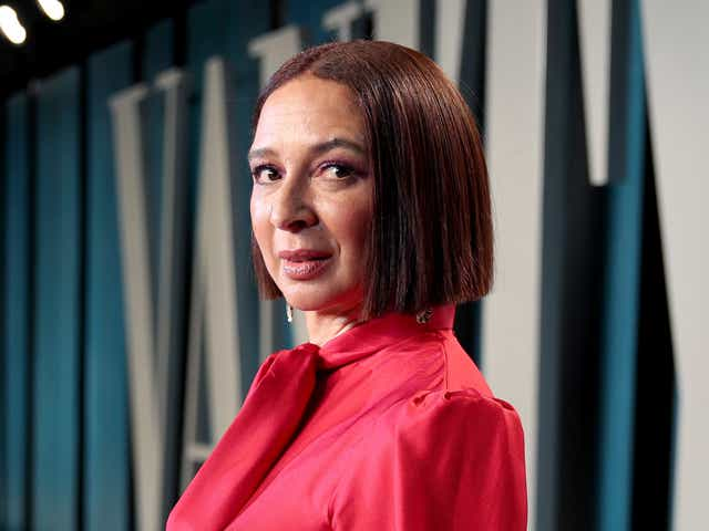 Maya Rudolph appears on a red carpet in a pink top.