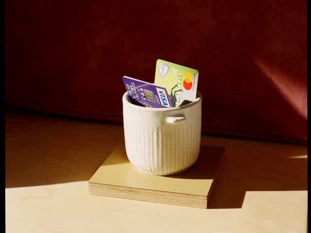 Image of two debit cards photographed in a small white pot