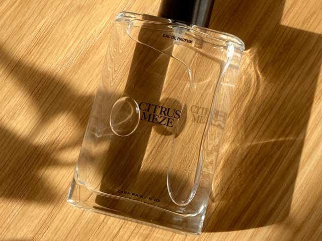 Zara No.03 Citrus Meze perfume bottle on a wooden table