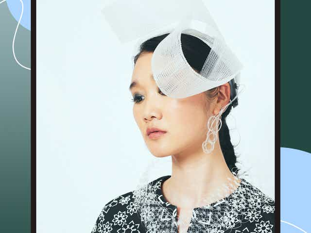 Japanese model Pippi wearing a hearing devise that allows her to see sounds.