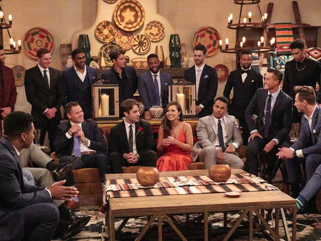 The Bachelorette cast surround Katie before a rose ceremony.